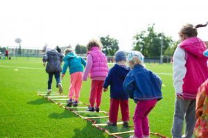 Children Playing on the School Field