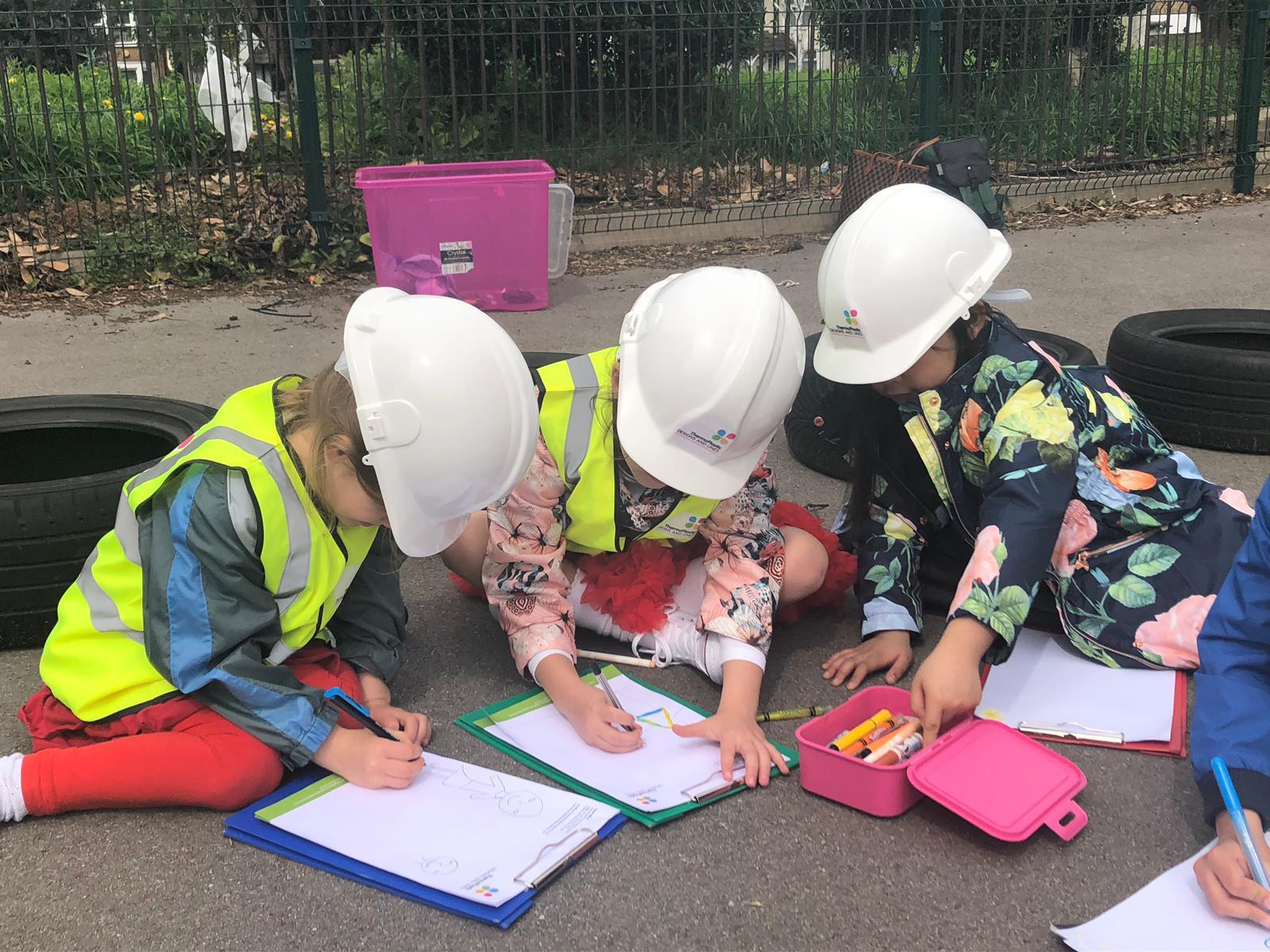 Children drawing the playground installation process