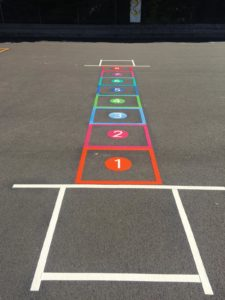 Painted Games on Playground Hopscotch