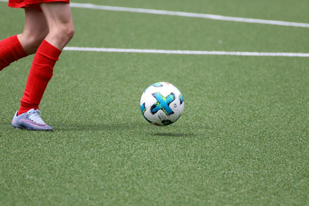 Footballer playing on an artificial pitch