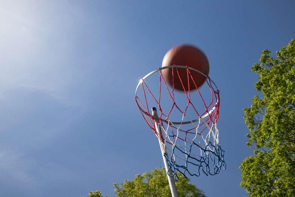 a ball entering the net during a school netball match